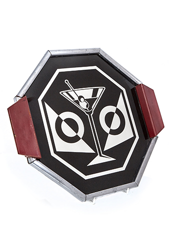 An octagonal mirrored drinks tray