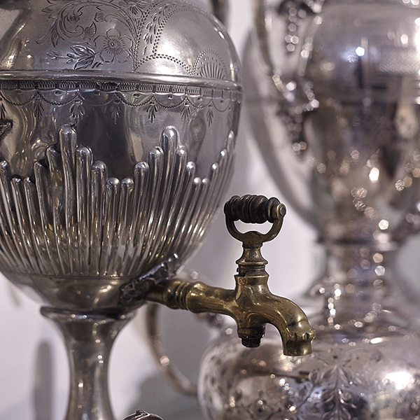 close up of antique silver urn