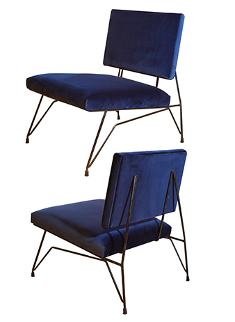 a pair of blue velvet chairs