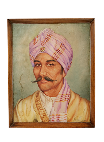 portrait of an Indian man with pink turban
