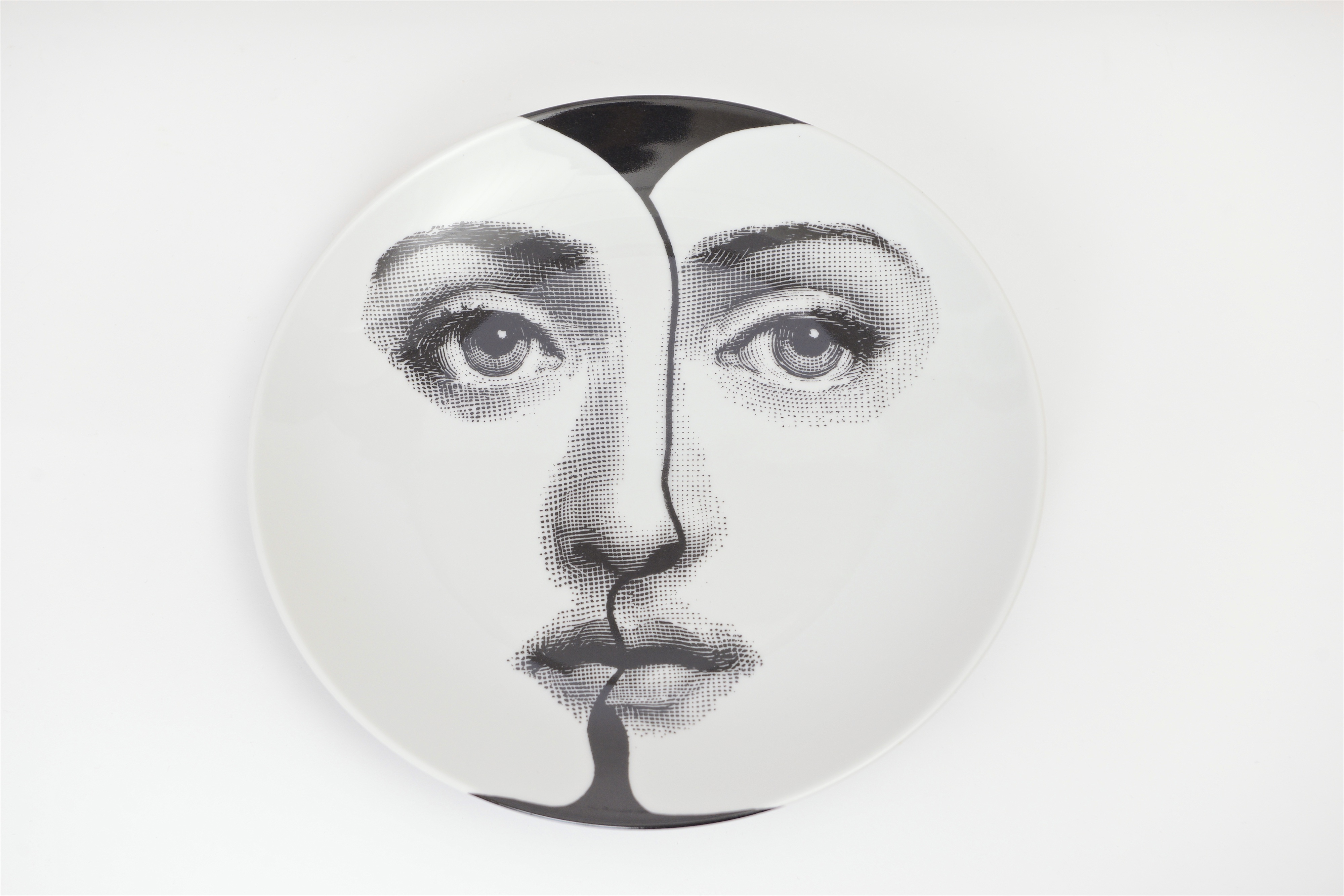 Black and white 'Themes and Variations' plate by Fornasetti