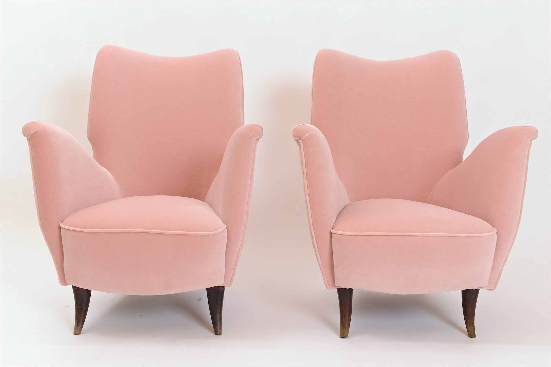 Pair of pink velvet upholstered armchairs